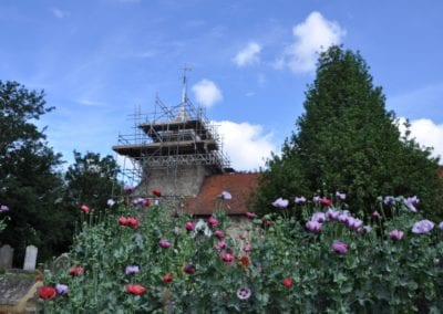 St Mary's spire with scaffold and poppies